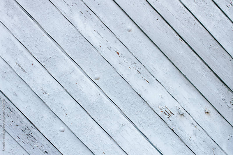 background of white painted wooden boards by Leander Nardin for Stocksy United