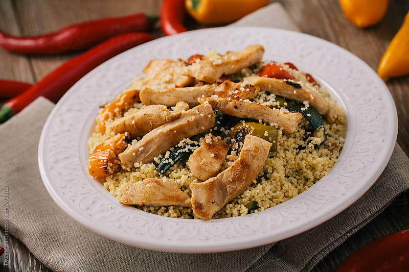 Cous Cous with chicken and grilled vegetables. by Davide Illini for Stocksy United