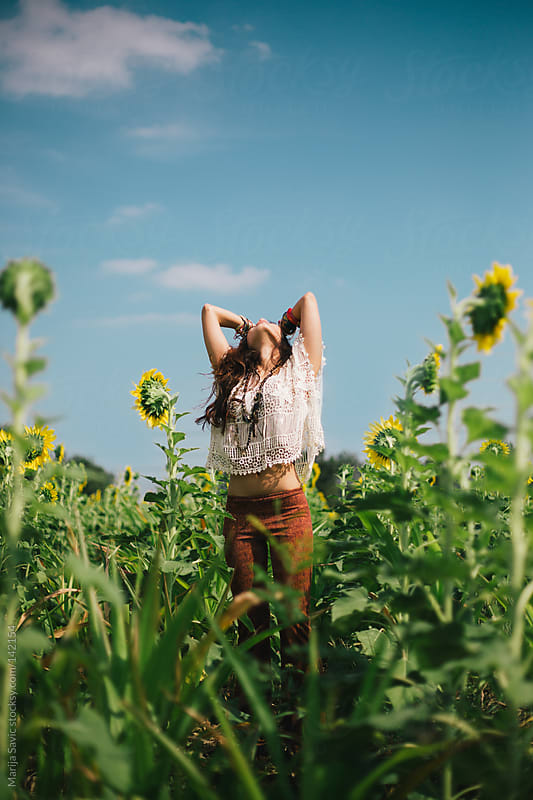 Woman in the Sunflower Field by Marija Savic for Stocksy United