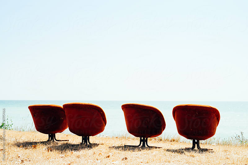 Old plush chairs overlooking the sea by Pixel Stories for Stocksy United