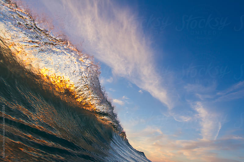 Sunset Wave Breaking in the Clouds  by Nathan French for Stocksy United