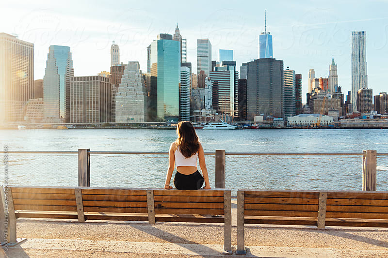 Beautiful brunette enjoying the sun in New York City by Good Vibrations Images for Stocksy United