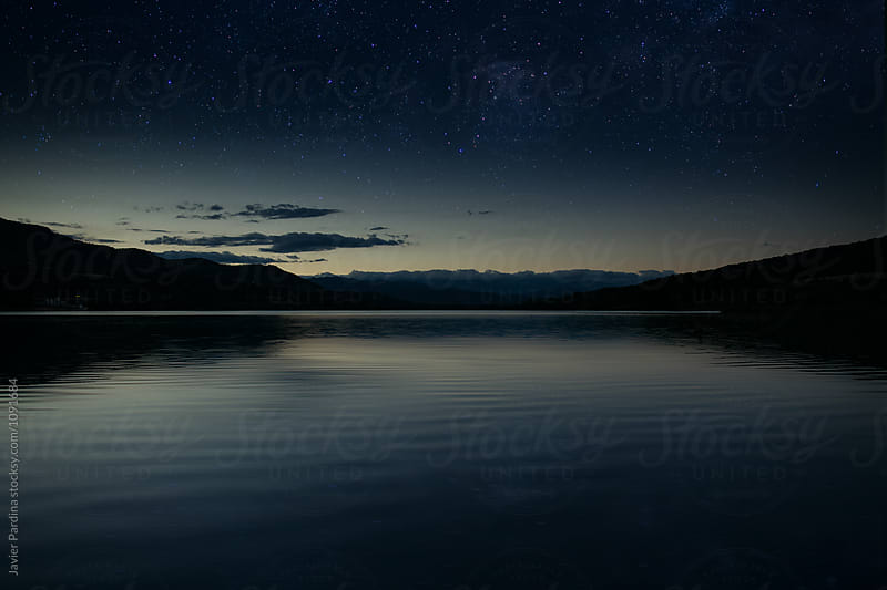 landscape with mountain and lake  at night by Javier Pardina for Stocksy United