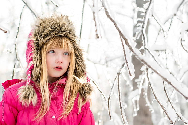 Little Girl Exploring Cold Winter Woods With Frozen Ice and Snow by JP Danko for Stocksy United