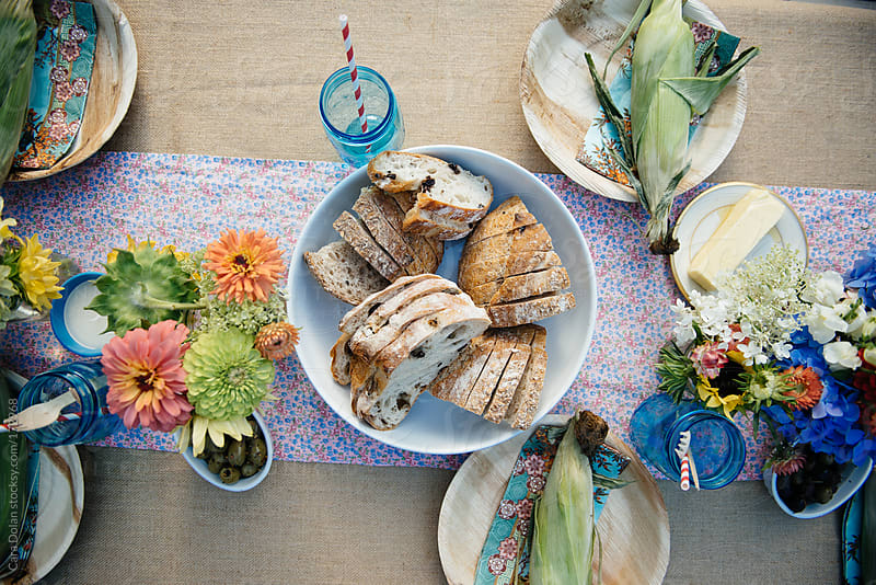 Table setting at a rustic outdoor party by Cara Dolan for Stocksy United