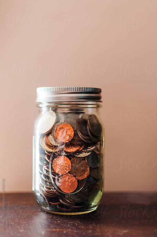 A jar of coins by Chelsea Victoria for Stocksy United