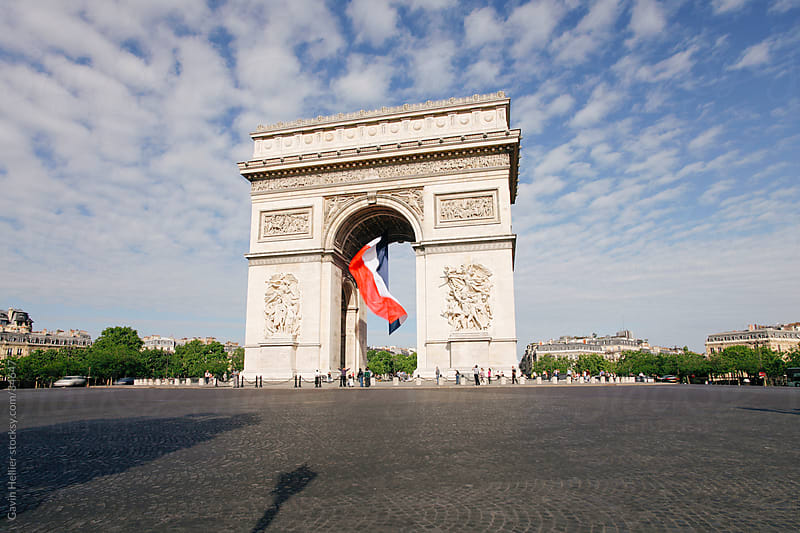 France, Paris, Etoile, French flag under Arc de Triomphe built by Napoleon by Gavin Hellier for Stocksy United