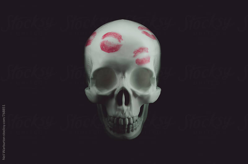 A skull with lipstick kisses on it by Neil Warburton for Stocksy United