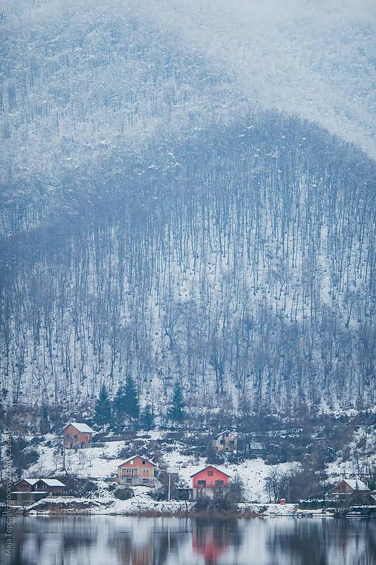 Lake reflections at winter by Maja Topcagic for Stocksy United