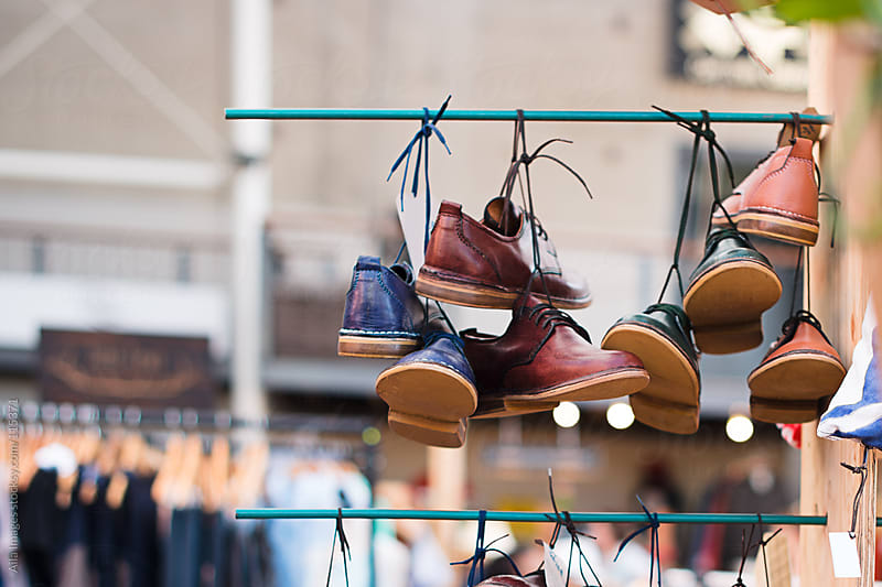 Shoes for Sale at a market by Aila Images for Stocksy United