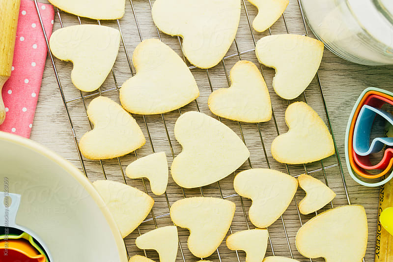 Heart shaped cookies on rack from above by Kirsty Begg for Stocksy United
