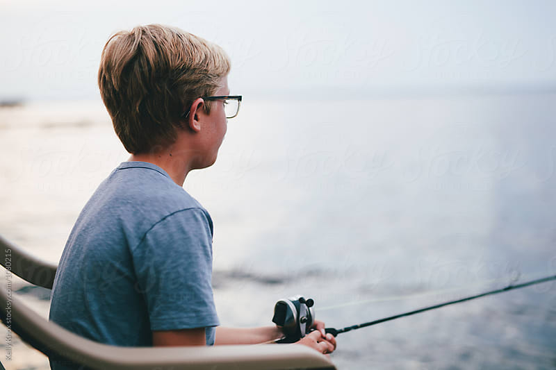 boy waiting to catch a fish by Kelly Knox for Stocksy United