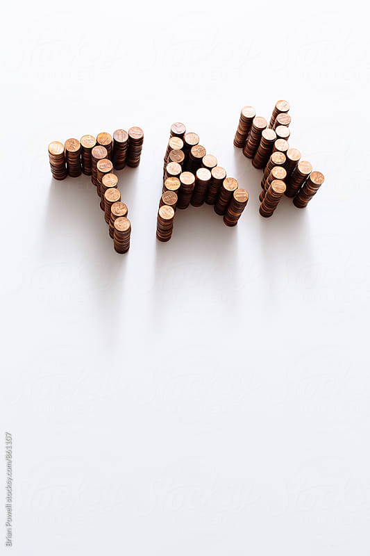 Tax created with stacks of coins by Brian Powell for Stocksy United