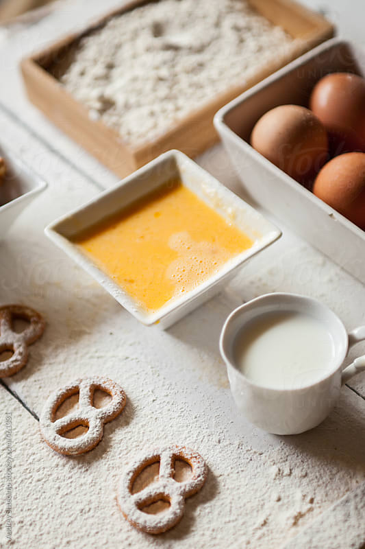 Ingredients for pretzels on white  wooden background by Audrey Shtecinjo for Stocksy United