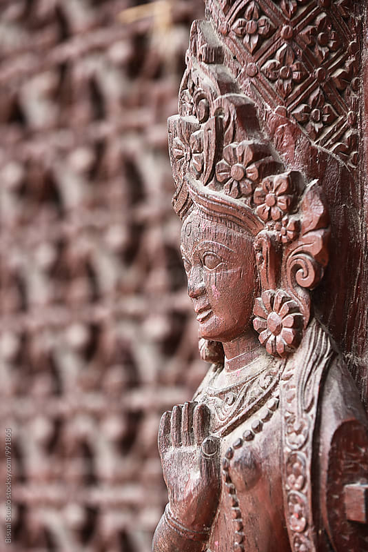 Goddess carved on a temple's wall by Bisual Studio for Stocksy United