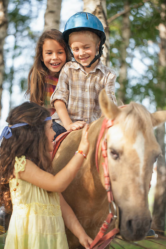 Children Riding a Horse by Lumina for Stocksy United