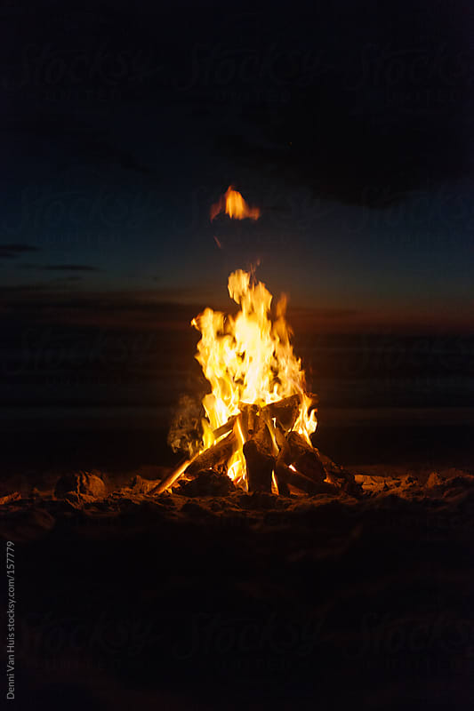 Campfire on the beach at night. by Denni Van Huis for Stocksy United