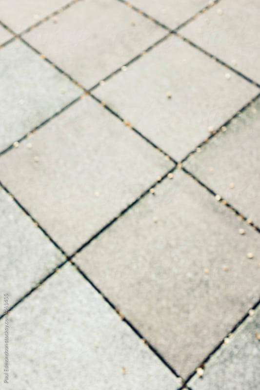 Square patterns on urban sidewalk by Paul Edmondson for Stocksy United