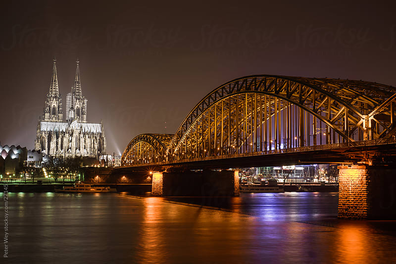 Hohenzollerrn brige at night with Dom in Cologne by Peter Wey for Stocksy United