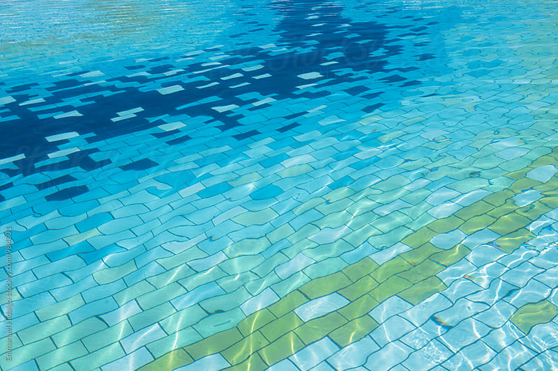 Unique colored tiles in a pool by Emmanuel Hidalgo for Stocksy United