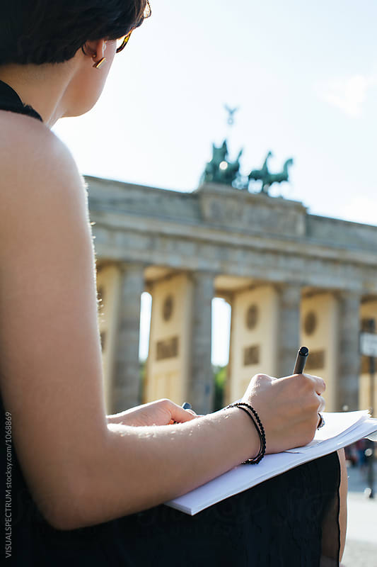 Closeup of Young Female Artist Drawing Berlin's Brandenburg Gate by Julien L. Balmer for Stocksy United