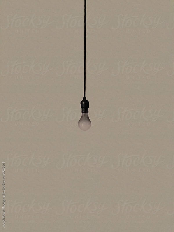 A hanging lightbulb by Joseph West Photography for Stocksy United