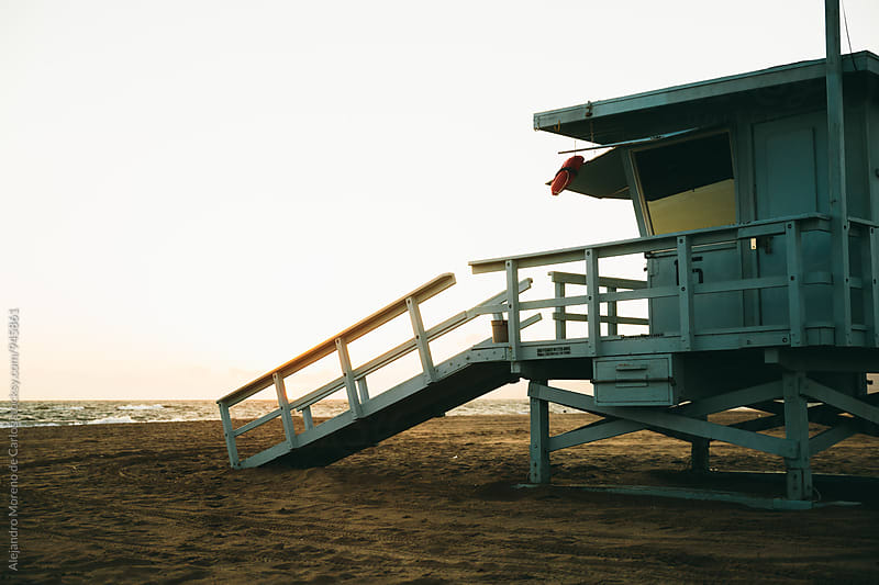 Traditional lifeguard cabin in California at sunset by Alejandro Moreno de Carlos for Stocksy United