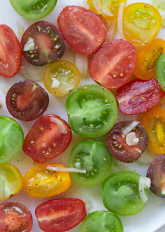 Close up of colorful baby tomato's by Sophia Hsin for Stocksy United