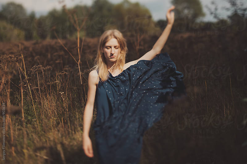The girl throws a dress in the field by Sergey Filimonov for Stocksy United