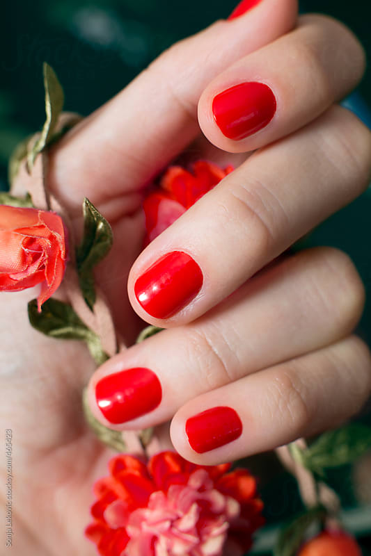 red manicure closeup by Sonja Lekovic for Stocksy United