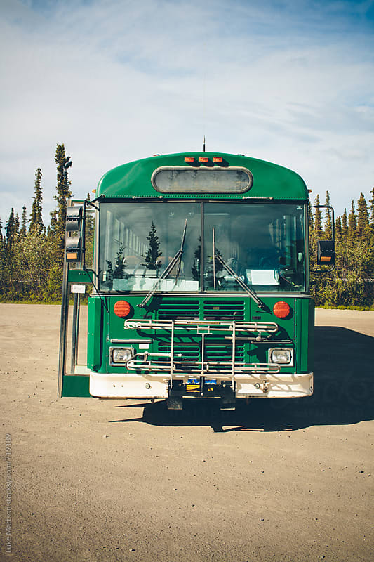 The Front Of A Green Tour Bus In Denali National Park by Luke Mattson for Stocksy United