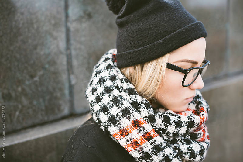 winter portrait of young woman with glasses. by Alexey Kuzma for Stocksy United