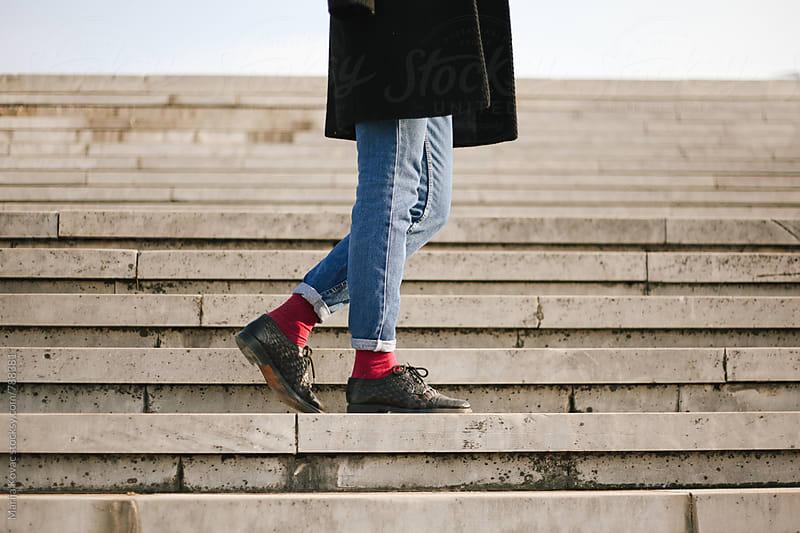 Female legs wearing jeans - horizontal by Marija Kovac for Stocksy United