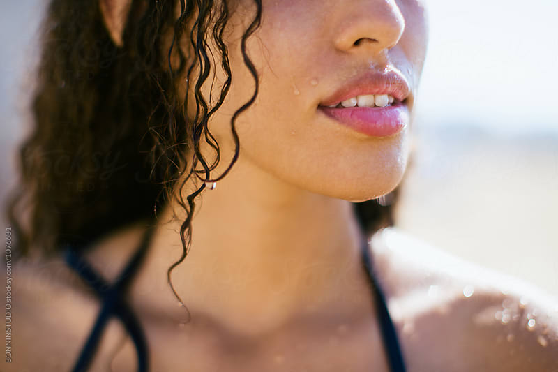 Closeup portrait of a young woman in the beach.  by BONNINSTUDIO for Stocksy United