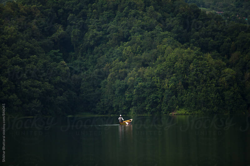 A fisherman in Begnas Lake. by Shikhar Bhattarai for Stocksy United