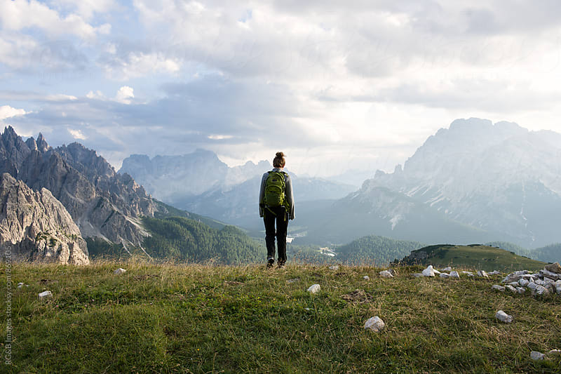 Hiker admiring the natural landscape in Dolomites Mountains by RG&B Images for Stocksy United