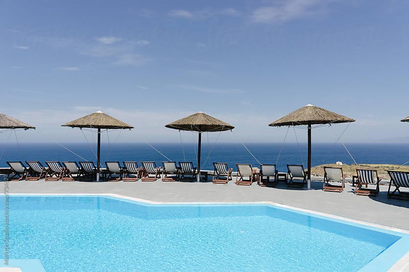 Swimming pool in a luxury Hotel of Santorini by MaaHoo Studio for Stocksy United