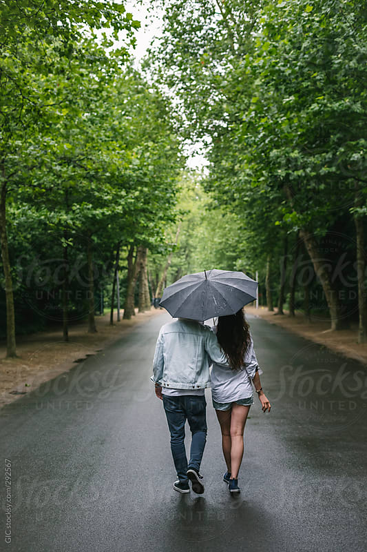 Couple walking together under the rain by GIC - Rain ...