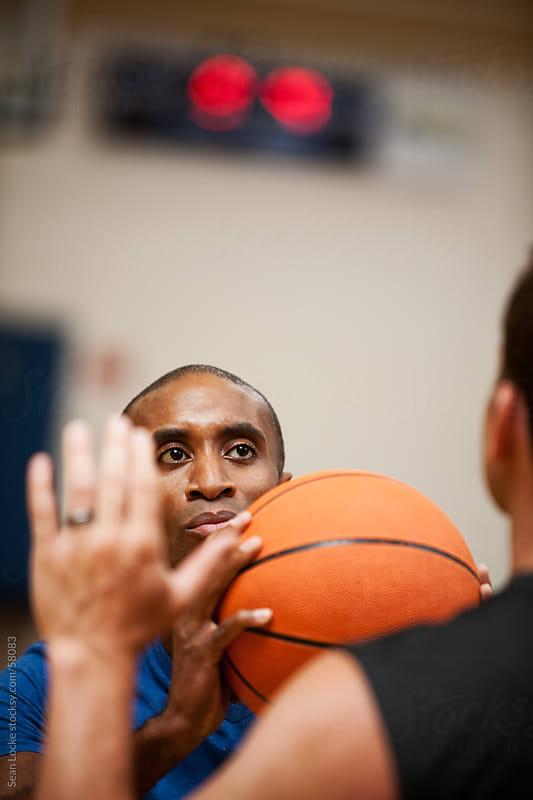 Gym: Man Ready to Shoot Basketball by Sean Locke for Stocksy United