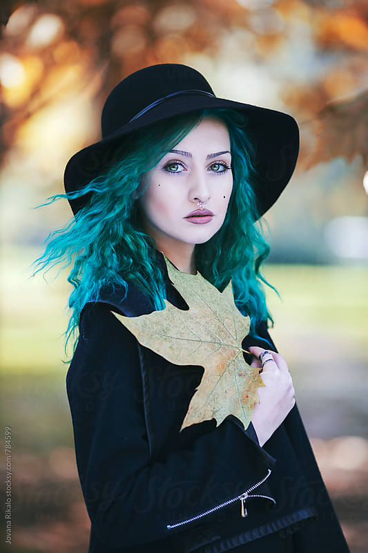 Portrait of a beautiful young woman with green hair and eyes by Jovana Rikalo for Stocksy United
