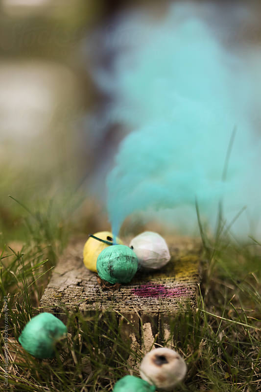 Colorful smoke bombs by Carolyn Lagattuta for Stocksy United