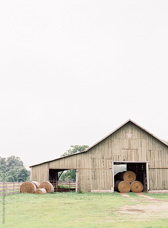Barn with hay bales  by Vicki Grafton Photography for Stocksy United