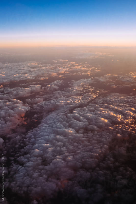 Cloud surface and atmosphere at sunset by Micky Wiswedel for Stocksy United