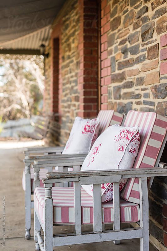 verandah with vintage chairs   by Gillian Vann for Stocksy United