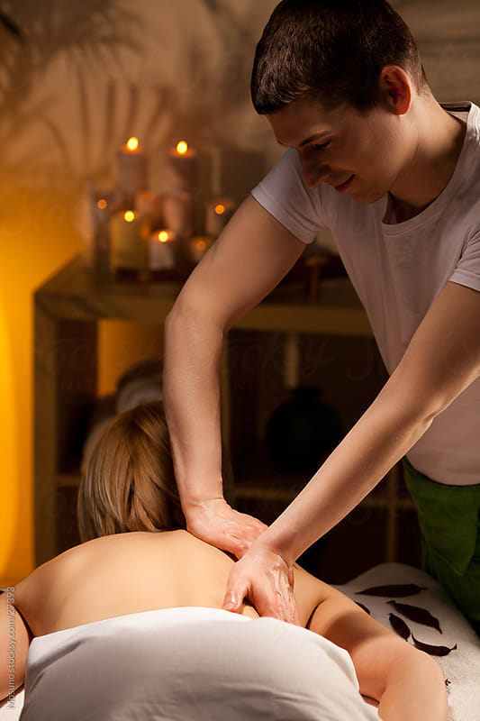 Woman enjoying massage in spa. by Mosuno for Stocksy United