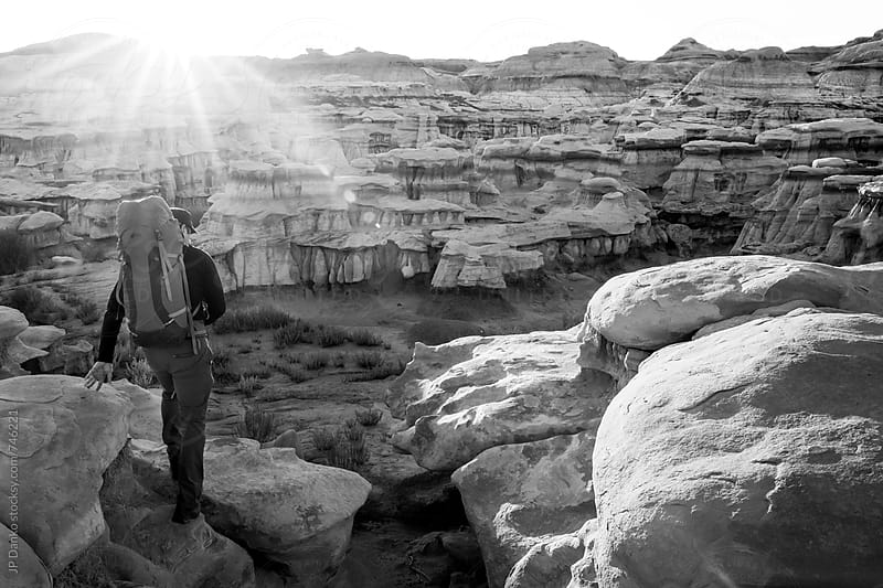Backpacker Hiking in Bisti Badlands Wilderness Area New Mexico at Sunrise Black and White by JP Danko for Stocksy United