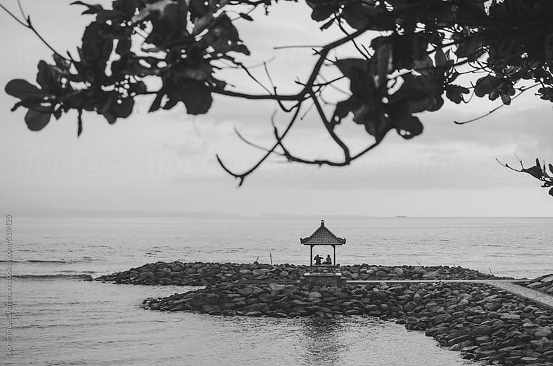 Balinese shrine out by ocean by Dominique Chapman for Stocksy United