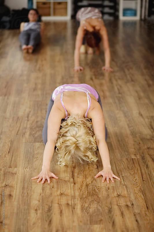 Women in yoga class by rolfo for Stocksy United
