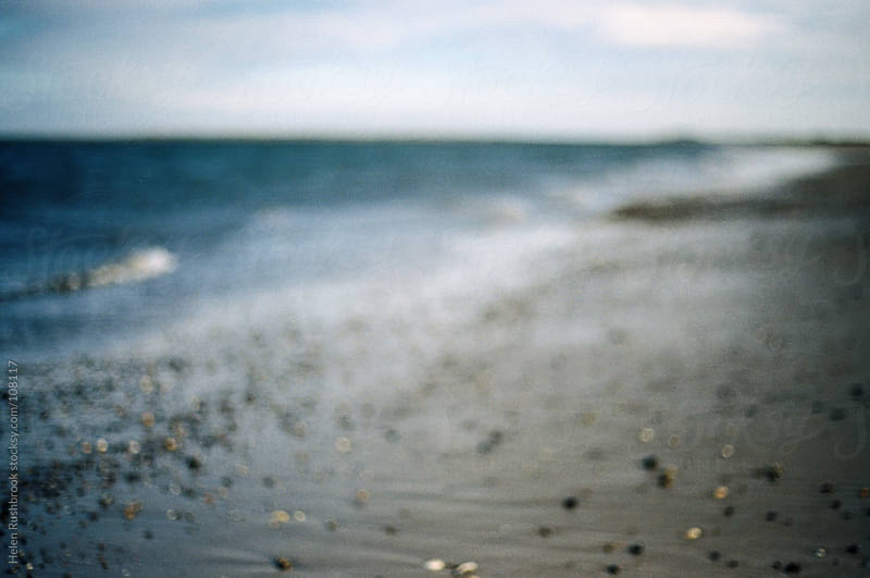 A blurry, impressionistic image of a beach by Helen Rushbrook for Stocksy United