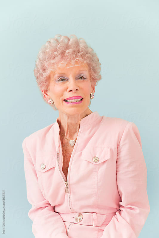 Senior dressed in pink by Ivan Solis for Stocksy United